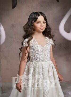 Long tulle skirt dress with white flower appliquéd hem and princess bodice for girls