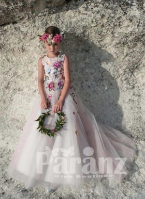White gown with long tulle skirt and floral embroidery bodice