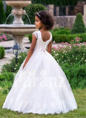 Light pink cap sleeve elegant baby gown with floor length lace hem flared tulle skirt back side view