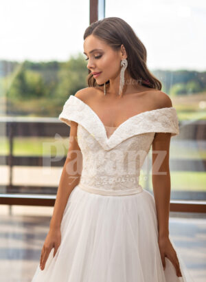 Women's beautiful off-shoulder styled floor length tulle gown with glam bodice close view
