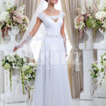 Women's floor length sleek satin wedding gown with floral lace work in white