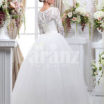 Women's full sleeve beautiful lacy bodice flared tulle skirt wedding gown in white back side view