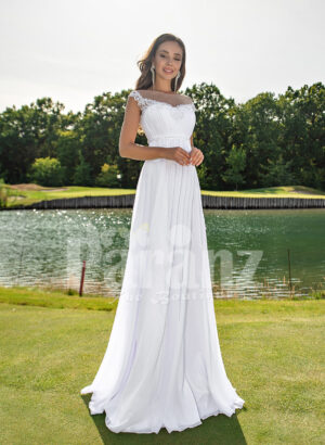 Women's long white wedding tulle gown with sophisticated sleeveless bodice