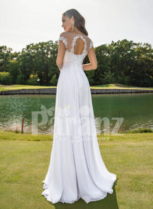 Women's long white wedding tulle gown with sophisticated sleeveless bodice back side view
