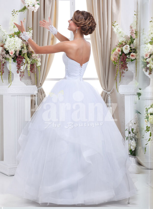 Women's off-shoulder super stylish pearl white wedding gown with high volume tulle skirt back side view