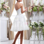 Women's tea length pearl white wedding tulle gown with off-shoulder bodice side view